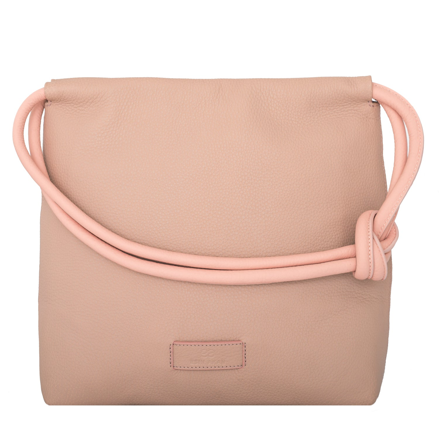 A convertible leather pink shoulder bag for women with a knot detail on the strap that could be used as a clutch bag with its roll down feature, front image.