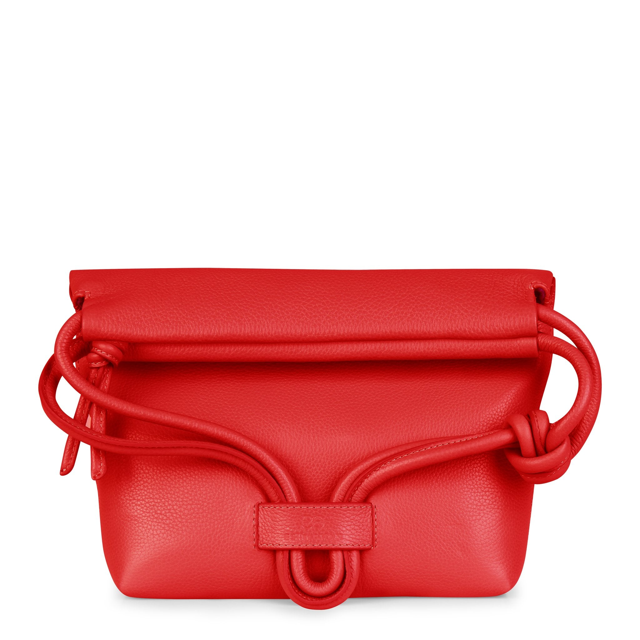 A convertible leather red shoulder bag for women with a knot detail on the strap shown as a clutch bag, front image.