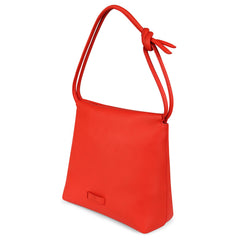 A convertible leather red shoulder bag for women with a knot detail on the strap that could be used as a clutch bag with its roll down feature, side image.
