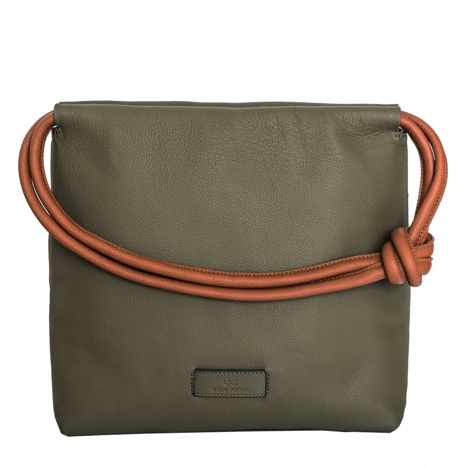 A convertible leather green shoulder bag for women with a knot detail on the strap that could be used as a clutch bag with its roll down feature, front image.