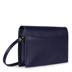 A convertible leather navy clutch bag with a knot detail in front that could be used as a crossbody bag, back image.