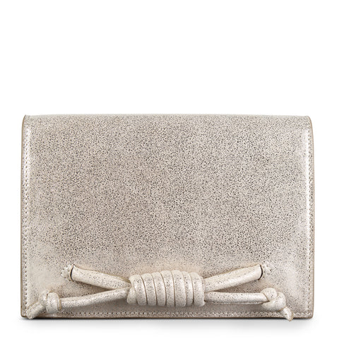 A convertible leather gold clutch bag with a knot detail in front that could be used as a crossbody bag, front image.