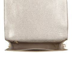 A convertible leather gold clutch bag with a knot detail in front that could be used as a crossbody bag, interior image.