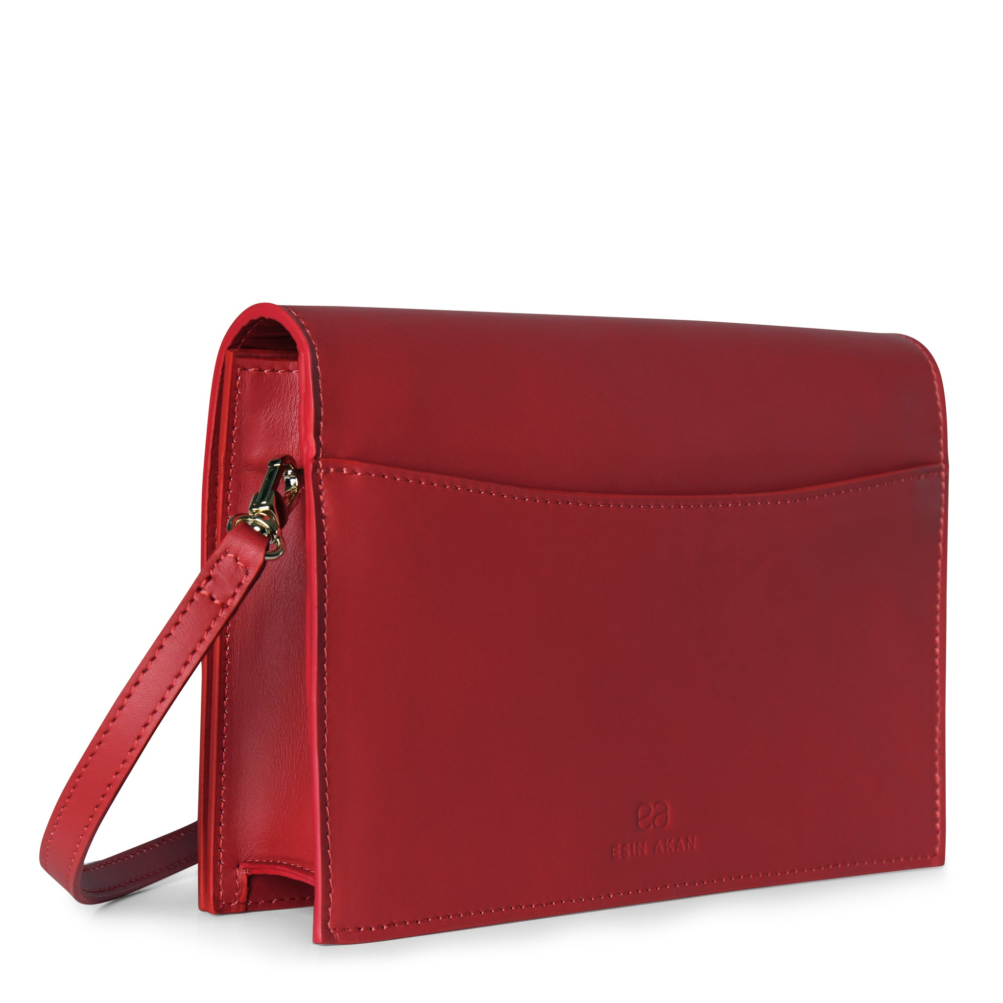 A convertible leather red clutch bag with a knot detail in front that could be used as a crossbody bag, back image.