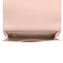 A convertible leather pink clutch bag with a knot detail in front that could be used as a crossbody bag, interior image.