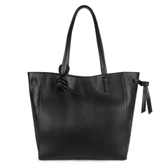 A black leather tote bag for women shown as a travel bag.