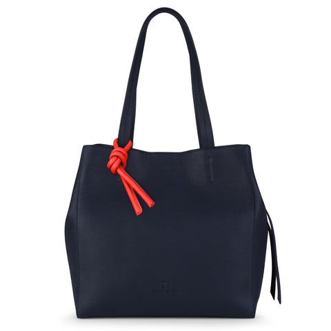 An expandable leather tote bag for women in navy and red that could be used as a travel bag, front image.