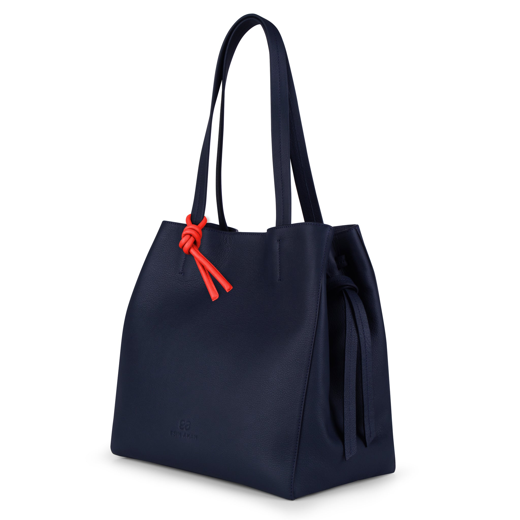 An expandable leather tote bag for women in navy and red that could be used as a travel bag, side image.