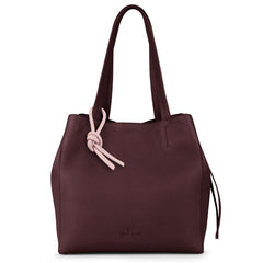 An expandable leather tote bag for women in burgundy and pink that could be used as a travel bag, front image.