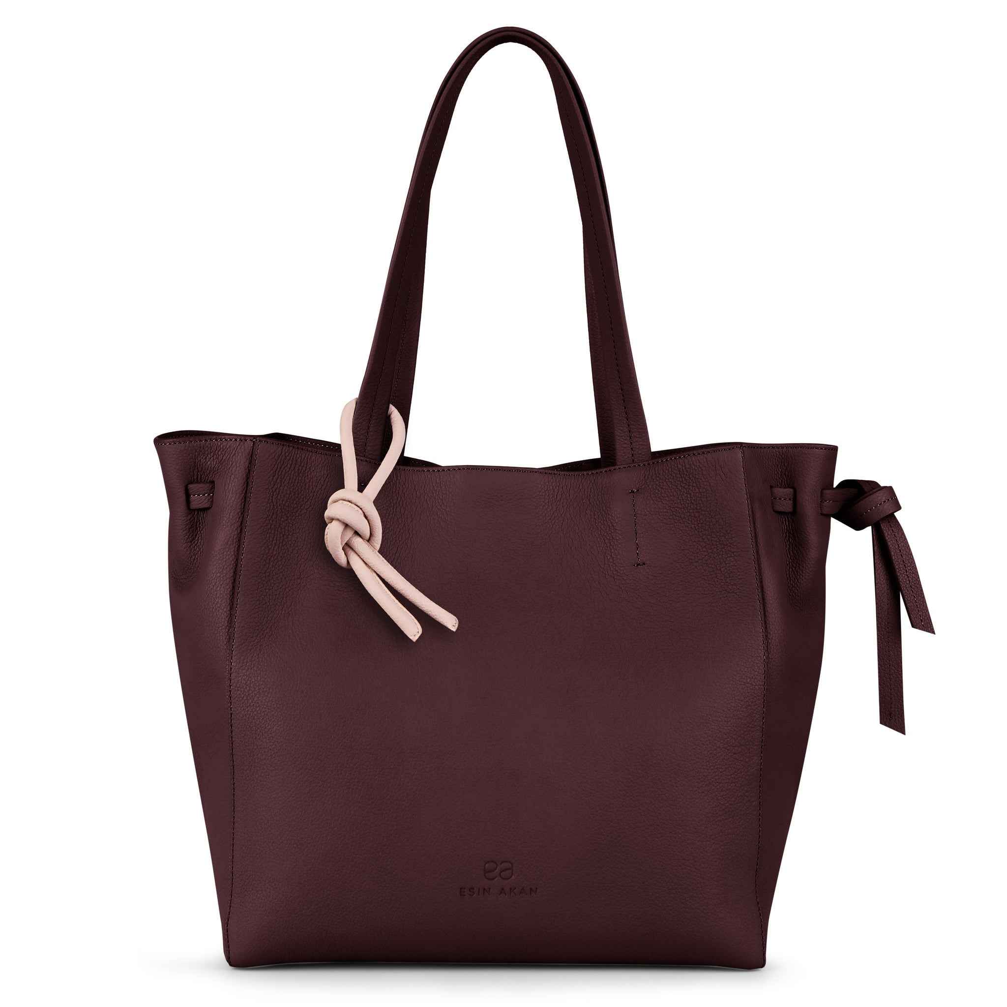 An expandable leather tote bag for women in burgundy and pink shown as a travel bag, front image.