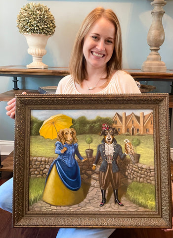 Olivia holding a painting