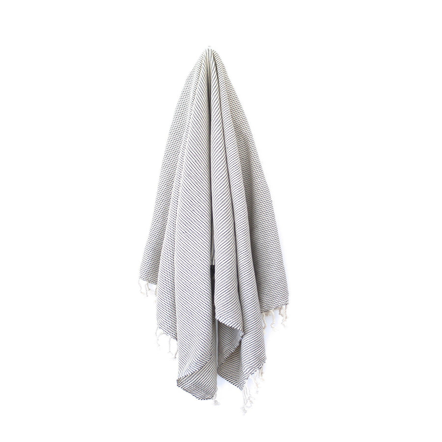 Organic Turkish Kai black towel hanging