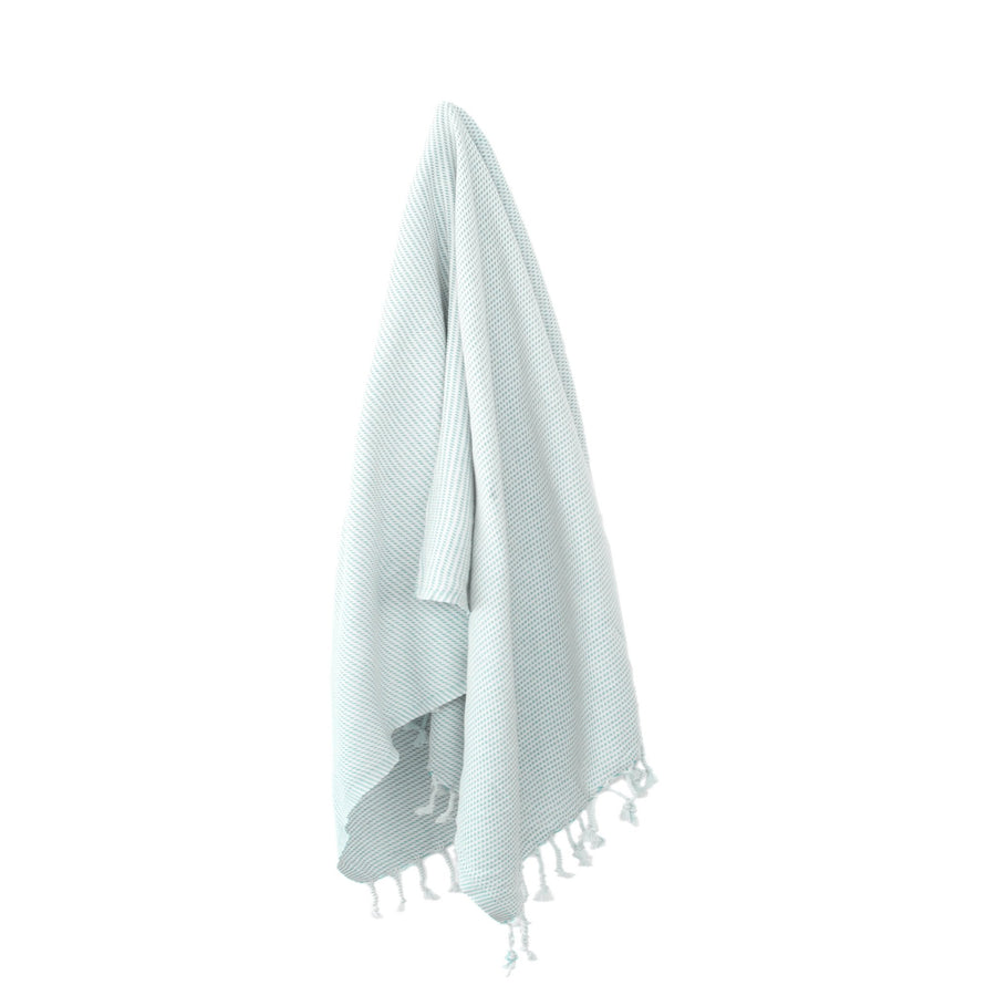 Organic Turkish Kai blue glow towel hanging