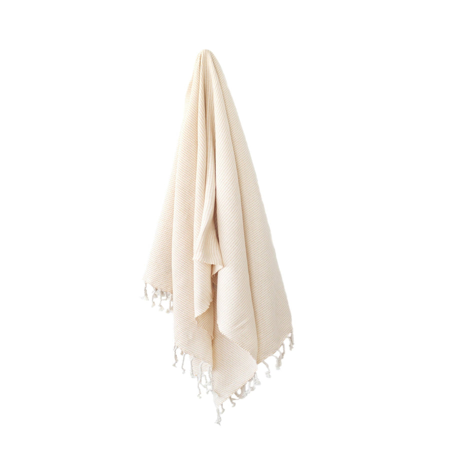 Organic Turkish Kai tangerine towel hanging