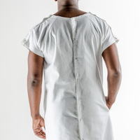 Back of hospital gown showing snaps