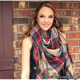 Large Plaid Bold patterns. One of this seasons favorite accessories the large plaid blanket scarf in beige.