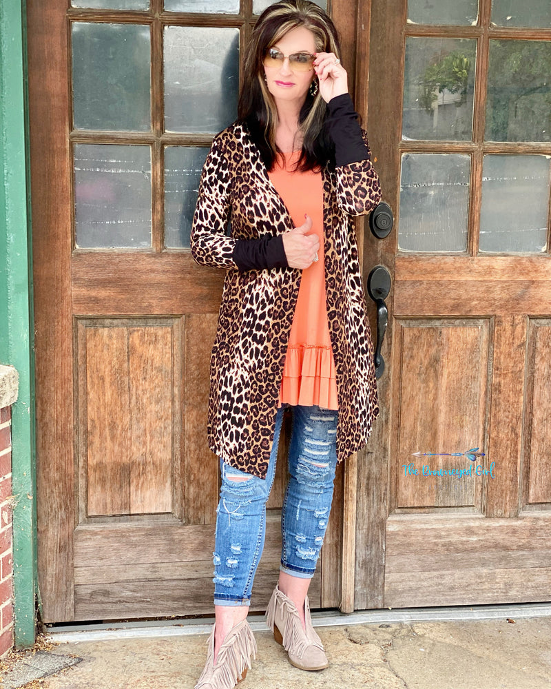 Woman Wearing An Animal Print Thumbhole Cardigan With Contrasting Cuffs