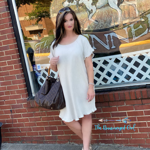 Umgee cream leopard back short sleeve dress. The dress is a hi-lo with raw edgy ruffle hem line.