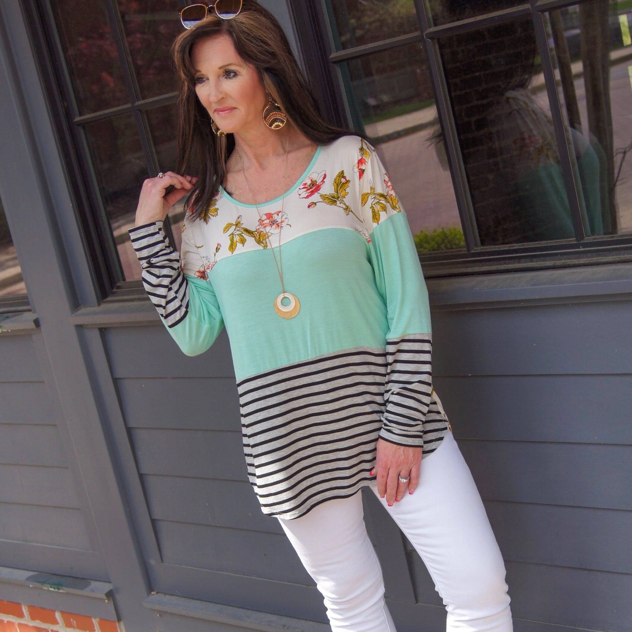 Woman Wearing A Spring Mix Floral Stripe Color Block Tunic Long Sleeve Material IS Soft And Stretchy Light Weight