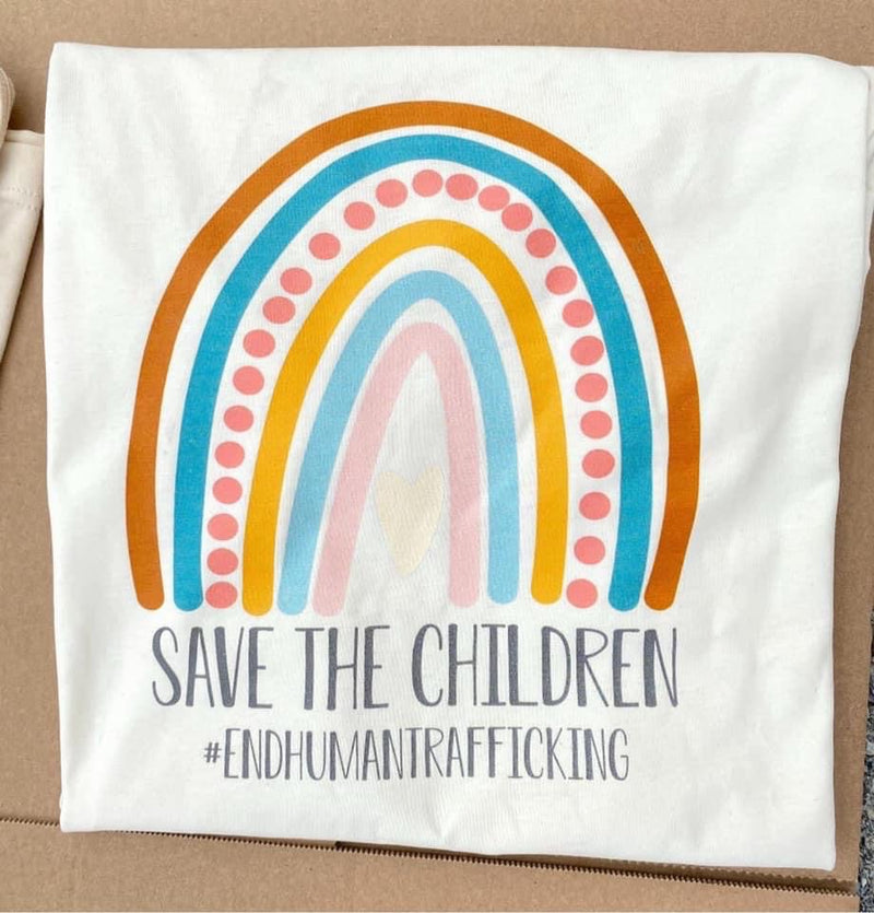 Save The Children Tee This is a real life photo of the actual print done on the tee it self .  Thebrowneyedgril-Boutique/Save The Children/product