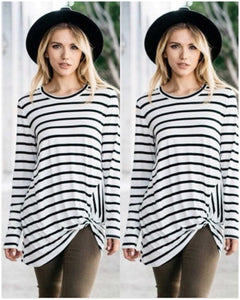 Black and ivory striped side knot twisted tunic. Extremely flattering fit  long sleeve and scope neck line