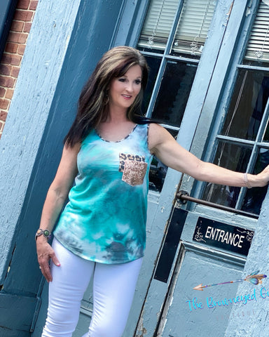 "Woman wearing a jade tie-dye tank with a crew neckline. Double front pocket's sequin and leopard. This tank is ultra comfy fits true to size. Model is a size 7 38"" bust wearing a medium."