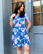 Woman Wearing Blue Floral  Print Above The Knee  Dress. Short Sleeve And The Cute Fit To Flare. This Dress Fits True To Size