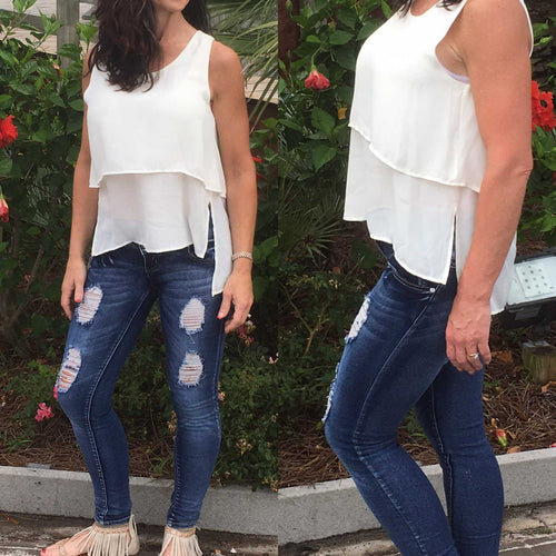Tiered Layers  Off Woman wearing white layered tank top with a high -lo hemWhite Tank - TheBrownEyedGirl Boutique