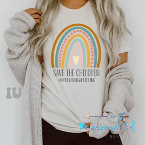 Woman wearing Save The Children End Human Traffickikng Short Sleeve Bella Canvas Tee  Uni sex Fit SMall-4x
