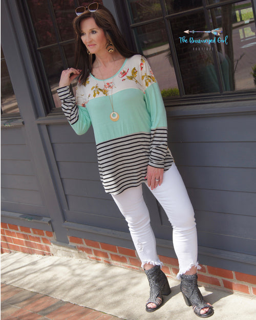 woman wearing A Spring Ivory,Mint, and stripe color block tunic. Rounded neck and hem line. Material iIs Soft And Stretchy USA MADE Plus Size