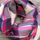 Bold plaid patterns are one of the seasons hottest items. This fuchsia bold plaid blanket scarf is soft and cozy while giving you the ideal layer