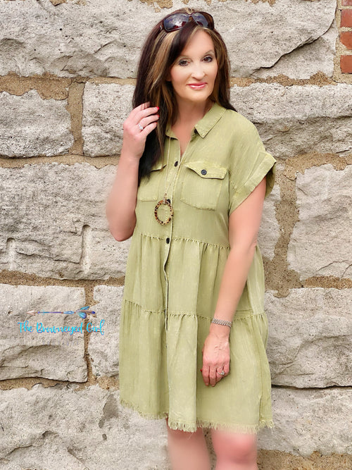 Woman wearing a Umgee Olive Button Down Short Sleeve Dress With Chest Pockets