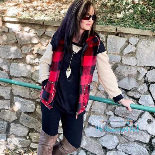 Woman Wearing Buffalo Plaid Vest Trimmed In Leopard Print