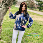 Women wearing a waffle knit tie-dye hoodie with bubble sleeves. Colors are cobalt blue, white,cream, and grey ,Ultra soft waffle knit fabric use Made Fits true to size. Model wearing size medium