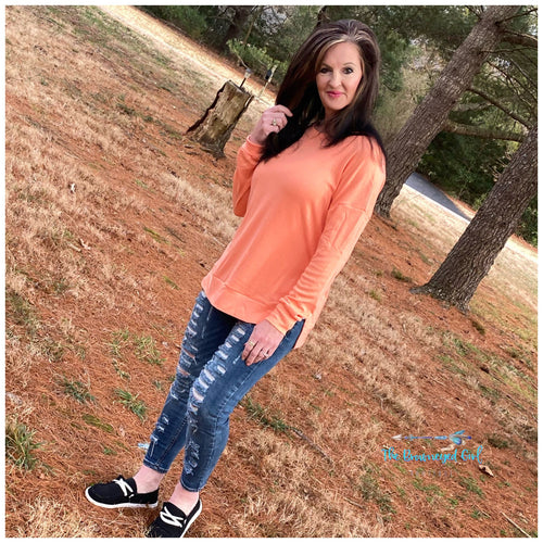 Woman wearing a Tangerine  Long Sleeve Spilt Knit Top