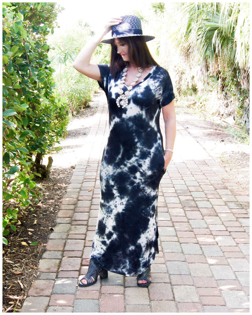 Midnight Magic Tie-Dye Maxi Woman wearing a ivory and dark navy tie-dye maxi dress short sleeve with a v-neck line and side pockets. Material is ultra soft and stretchy with side slits but not to far. - TheBrownEyedGirl Boutique