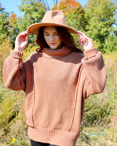 Woman Wearing A Camel Colored Heavy Knit Turtle Neck Sweater Premium Quality