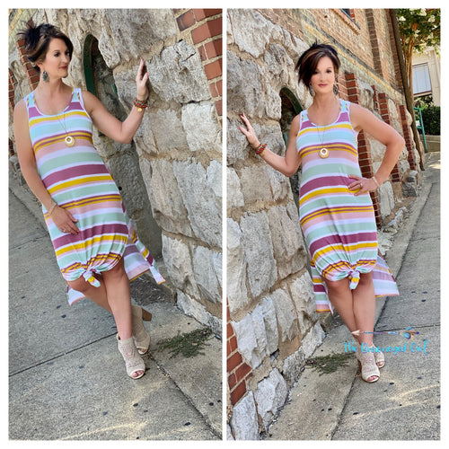 Woman wearing a summer style striped tank maxi dress. In soft summer colors that carry you over to fall. This dress pairs with our ribbed knit cardigans perfectly. Model is a size 7
