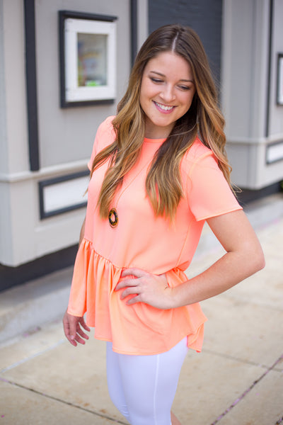 Coral Peplum Top