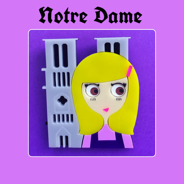 NOTRE-DAME Acrylic Brooch, Brown eyes blonde standing before Notre-Dame de Paris Cathedral - Isa Duval