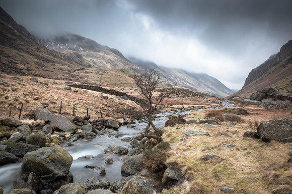 Afon Nant Peris, Snowdonia - North Wales. The river that runs along the pass from Pen y Pass towards Llanberis. Dark clouds settle above this moody looking landscape. Smart Imaging & Framing Landscape Photography
