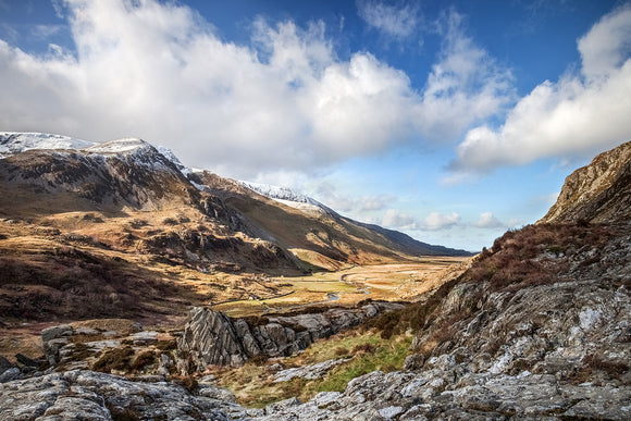 Nant Ffrancon Valley, Spring in Snowdonia - cloudy blue skies above and a sunkissed valley below. A fantastic Snowdonia countryside scene at Ogwen Valley