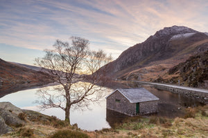 Just after the sunrise on this Winter's day at Llyn Ogwen in Snowdonia, North Wales. Very muted colours fill the cloudy sky and reflect in the lake below. Smart Imaging & Framing Landscape Photography