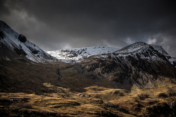 Shadow & Light Nant Ffrancon Valley - A very atmospheric image from Ogwen Valley in Snowdonia National Park. Dark Skies over the mountainside with just a shaft of sunlight to brighten the foreground