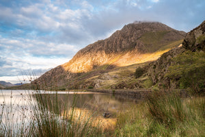 Tryfan Mountain in Snowdonia North Wales. Blue cloudy sky with Sun beam across mountain. Photography, Photo, Photograph, Smart Imaging