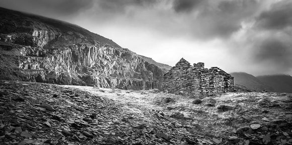 B&W The Quarry Face - Dinorwic Quarry - A stormy day in Snowdonia National Park with the grey sky above imitating the slate colour below