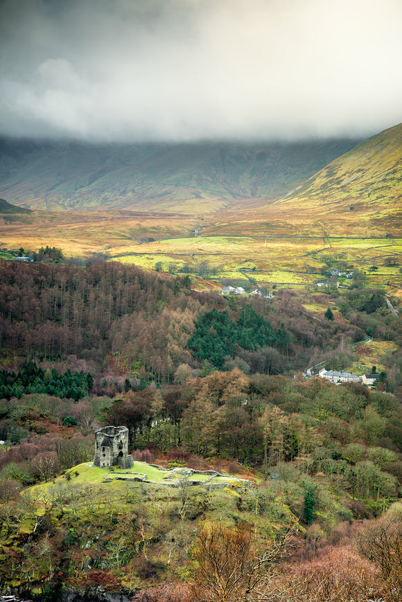 Dolbadarn Castle - A View from Above. An aerial view from above Llanberis looking down onto Dolbadarn Castle and the surrounding trees and landscape of Snowdonia National Park. ©Smart Imaging, North Wales