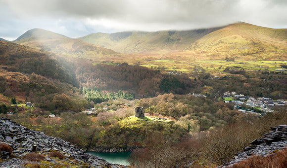 Spotlight on Dolbadarn Castle. A single ray of light illuminates the Castle at Llanberis, North Wales. Landscape photography in Snowdonia by Chris Smart of Smart Imaging