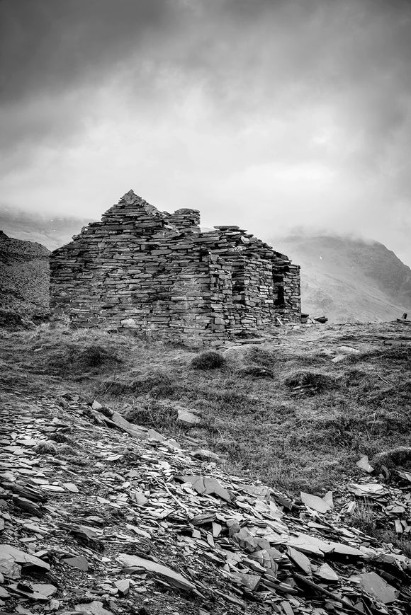 B&W The House that Slate Built - Dinorwic Quarry - A stormy day in Snowdonia National Park with the grey sky above imitating the slate colour below