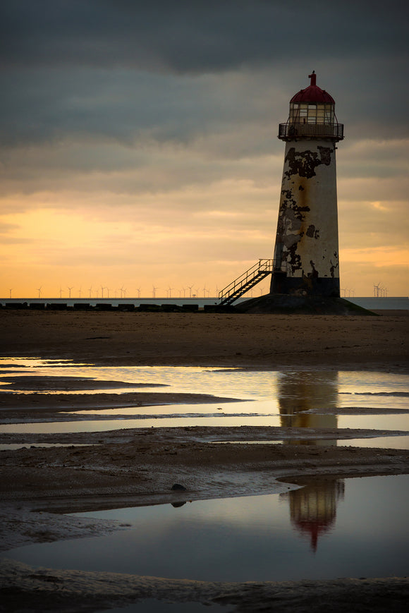 Point of Ayr lighthouse, with it's characteristic 'lean', is almost silhouetted against the stormy skies behind. The sunset on this evening only produced a small amount of colour but it was just enough to break up the predominently blue/grey tones in this image.